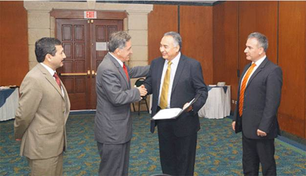 Mr. Carlos Guerrero, receiving the 2015 GeoSUR award from Mr. Santiago Borrero Mutis.